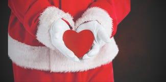 显示红色心脏形状的圣诞老人的综合图象 免版税库存图片