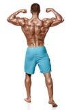 显示肌肉后面身体,背面图的性感的运动人,全长,被隔绝在白色背景 强的男性赤裸躯干 免版税库存照片