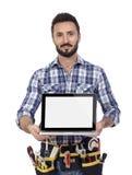 显示膝上型计算机的木匠 免版税库存照片