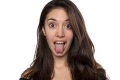显示舌头的女孩 免版税库存照片