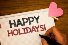 显示节日快乐诱导电话的文字笔记 庆祝欢乐天的企业照片陈列的问候供以人员拿着pe 免版税库存图片