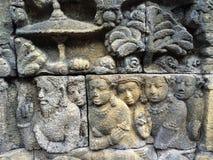 显示菩萨,婆罗浮屠寺庙,中爪哇省,印度尼西亚阁下生活的另外阶段的浅浮雕往涅磐的 免版税库存照片