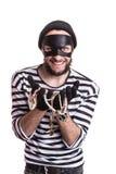 显示被窃取的宝石和微笑的匪徒 免版税库存图片