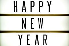 显示词组新年快乐的委员会的光 免版税图库摄影