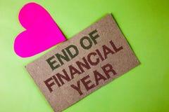 显示财政年度终的概念性手文字 企业照片文本收税时间会计6月数据库书面的成本单 库存图片