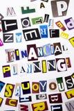 显示财政规划的概念词文字文本由企业案件的另外杂志报纸信件制成在whi 免版税库存照片