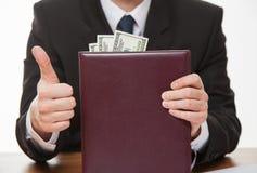 显示赞许和贿款的商人 库存图片