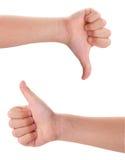 显示赞许的儿童的手和下来 免版税库存照片