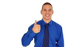 显示赞许的微笑的商人 库存照片