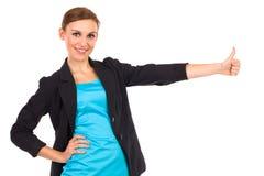 显示赞许的微笑的女实业家。 免版税库存图片