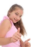 显示赞许的愉快的女孩 免版税库存图片