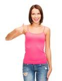 显示赞许的空白的桃红色衬衣的妇女 库存图片