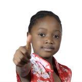 显示赞许的非洲女孩 免版税库存照片