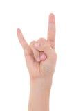 显示重金属的摇滚n卷标志的男性手隔绝在白色 免版税库存图片