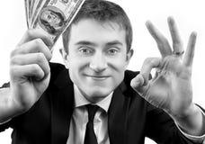 显示金钱和标志OK的爱好者商人 免版税库存照片