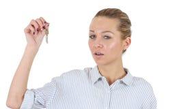 显示钥匙,白色背景的女实业家 股票录像
