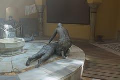 显示19世纪末的生活的雕刻的陈列在土耳其浴-哈马姆El Basha在老镇英亩  库存照片