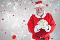 显示货币笔记的圣诞老人的综合图象 库存照片