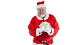 显示货币笔记的圣诞老人 库存照片