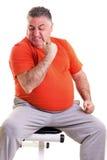 显示他的力量的超重人在做锻炼以后seted 库存照片