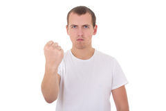 显示他的拳头的白色T恤杉的年轻人隔绝在白色 免版税图库摄影