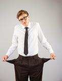 显示他空的口袋的万人迷商人 免版税图库摄影