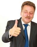 显示他赞许和微笑的愉快的商人 库存图片