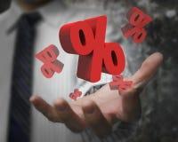 显示3D红色百分率符号的商人手 库存照片
