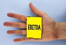显示Ebitda的概念性手文字 企业照片陈列的收入,在税被测量评估公司表现前 免版税库存图片