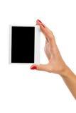 显示Polarid照片的手 免版税库存图片