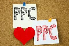 显示PPC的概念性手文字文本说明启发-每点击在st写的概念互联网SEO金钱和爱支付 库存照片