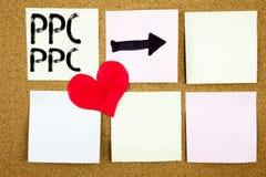 显示PPC的概念性手文字文本说明启发-每点击在wo写的概念互联网SEO金钱和爱支付 免版税库存图片