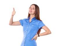 显示tumb标志的微笑的妇女 背景查出的白色 图库摄影