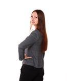 显示tumb标志的微笑的妇女 背景查出的白色 库存照片