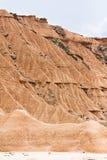 晃动在Bardenas Reales, Navarra,西班牙的山崩 免版税库存照片