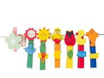 晒衣夹五颜六色的美好的微笑 免版税库存照片