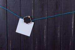 晒衣夹,与一个地方的纸题字的 免版税图库摄影