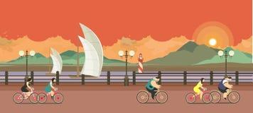 晚上码头骑自行车者 免版税库存图片