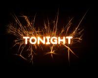 今晚在发光的闪烁发光物的词 库存照片