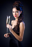 晚礼服的美丽的女孩与酒杯 前夕新的s年 图库摄影