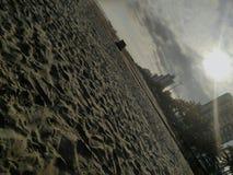 普腊亚重创的海滩沙子 免版税库存图片