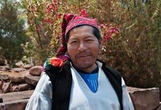 普诺,秘鲁- 2017年10月1日:戴典型的帽子的一个当地秘鲁人的画象 库存图片