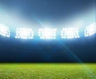 普通探照灯照明的体育场 图库摄影