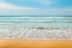 晴朗海滩的日 库存图片