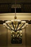 水晶枝形吊灯照明设备,墙壁灯台,温暖的光,希望光,打开您的梦想,浪漫时间 免版税库存照片