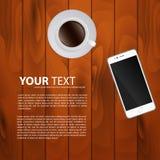 智能手机和杯子在木背景的浓咖啡 免版税库存图片