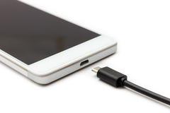 智能手机和被分开的数据缆绳 库存图片