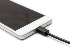 智能手机和被连接的数据缆绳 库存照片