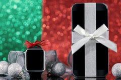 智能手机和smartwatch圣诞节的 库存图片