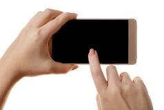 智能手机在一只女性手上 库存图片